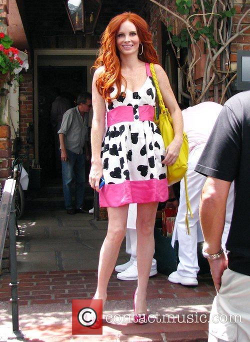 Phoebe Price posing outside The Ivy restaurant Los...