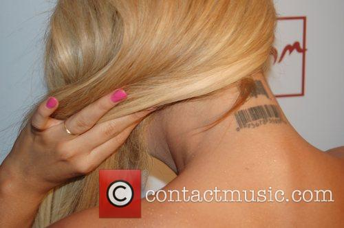 Aubrey O'Day shows off her barcode tattoo at...