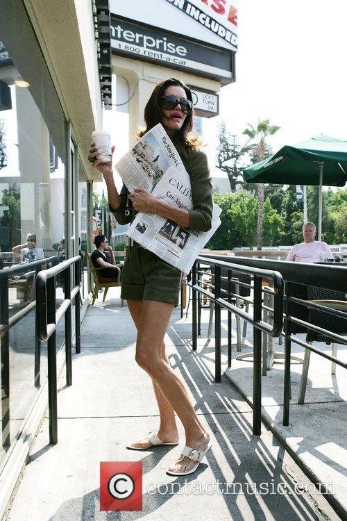 Janice Dickinson leaving Starbucks on Sunset Boulevard with...