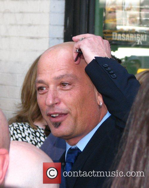 Howie Mandel talks with friends after receiving a...