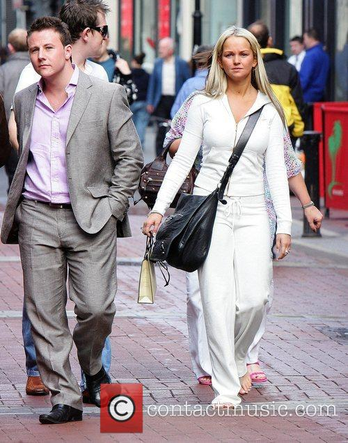 Spends the afternoon shopping in Grafton Street. She...