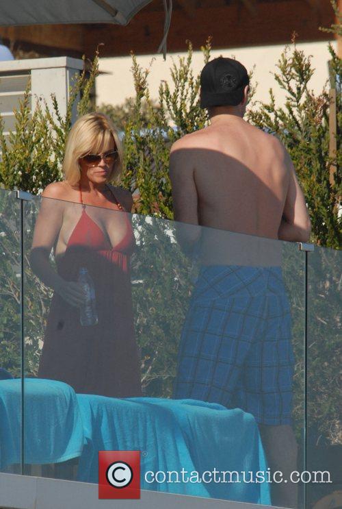 Jenny McCarthy and Jim Carrey sunbathing at their...