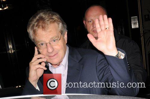British-born American television personality Jerry Springer talks into...
