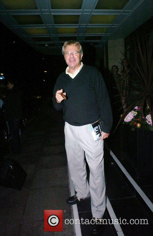 Jerry Springer  smokes a cigar outside the...