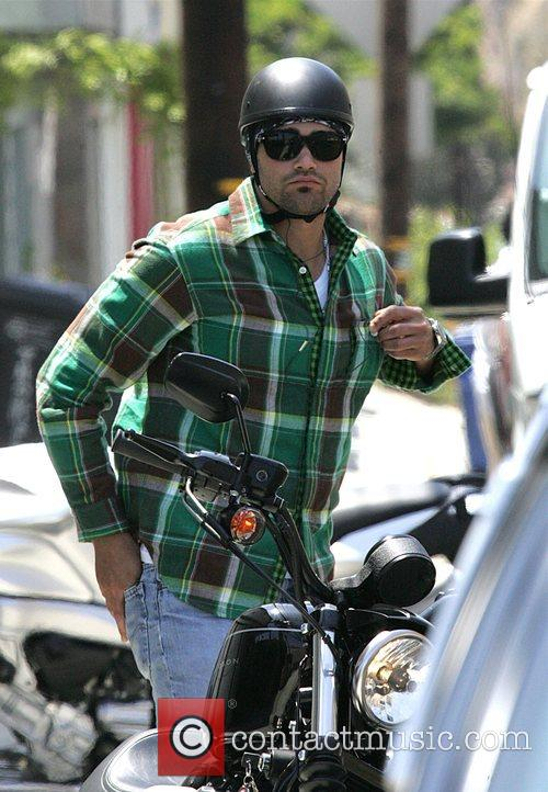 Jesse Metcalfe Takes his motorcycle out for a...