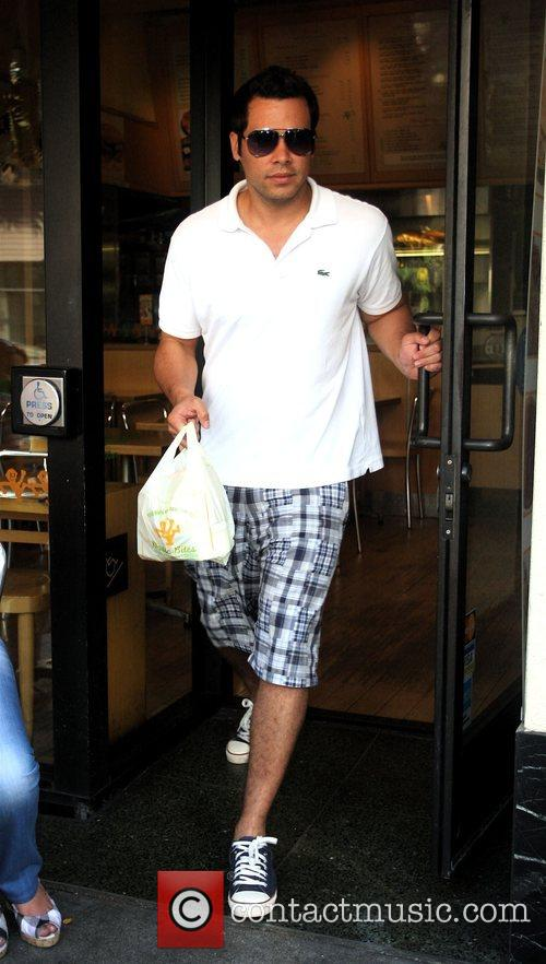 Has lunch with his wife and friends in...