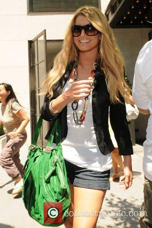 Jessica Simpson poses for photographers while out and...
