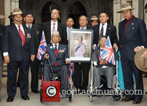 Gurkhas rally outside the High Court, where a...