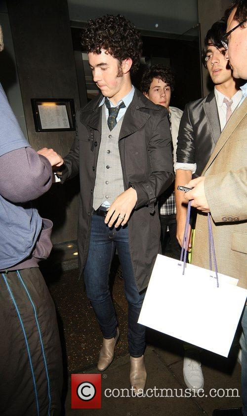 Kevin Jonas of the Jonas brothers leaving Nobu...