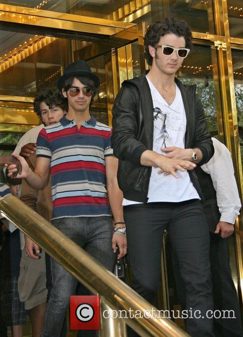 The Jonas Brothers are greeted by a frenzy...