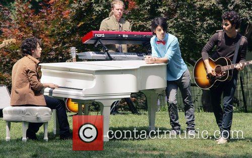 The Jonas Brothers on the set of their...