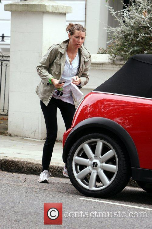 Jools Oliver A pregnant Jools leaving her house...