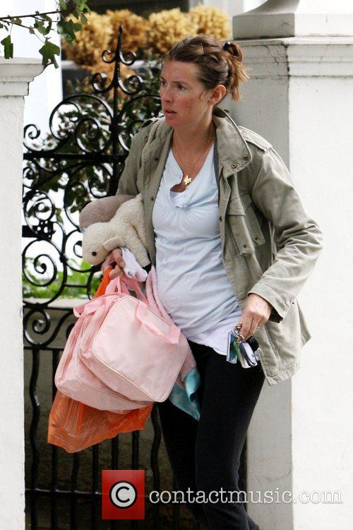 A pregnant Jools leaving her house this morning