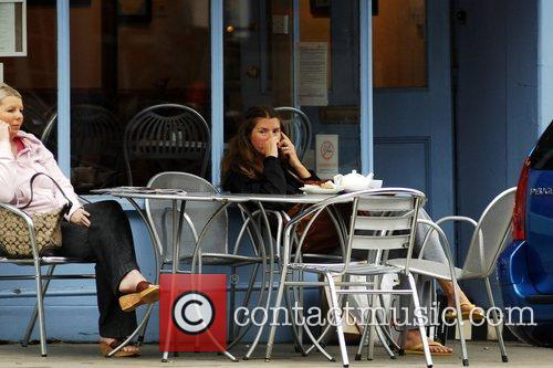 Jools Oliver Seen relaxing outside a cafe wearing...