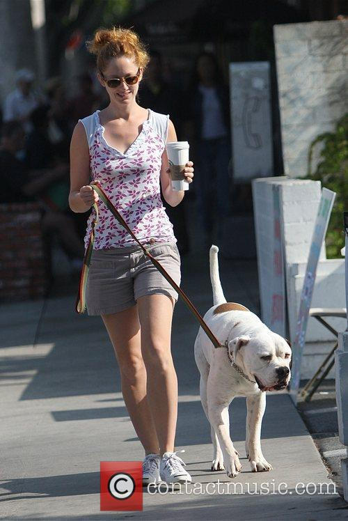 Stops at Starbucks as she takes her dog...