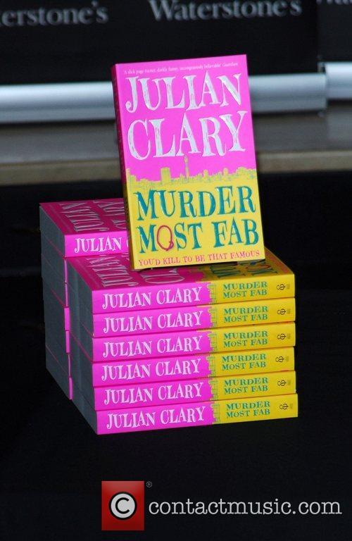 Julian Clary signing copies of his debut novel...
