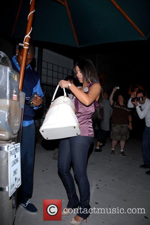 Reggie Bush and Kim Kardashian leaving Koi restaurant...