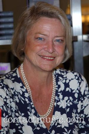 BBC war reporter Kate Adie signs copies of...