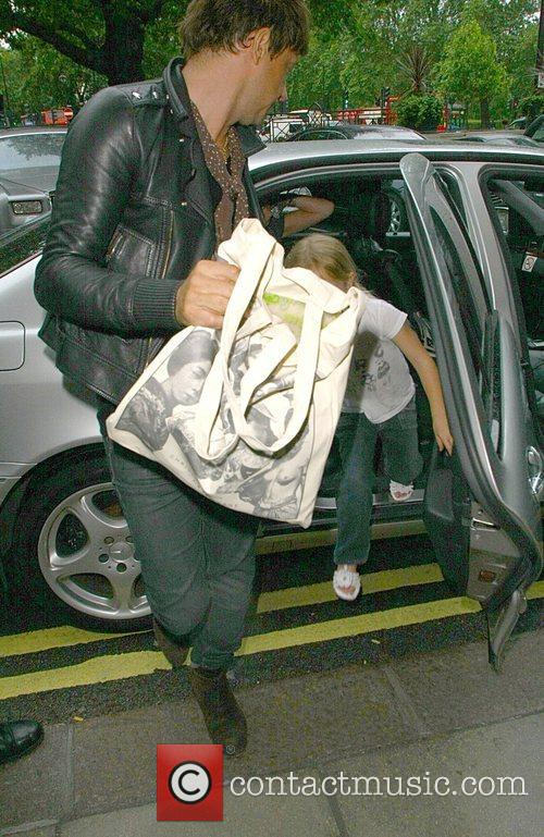 Arrives at the Dorchester with Kate Moss and...