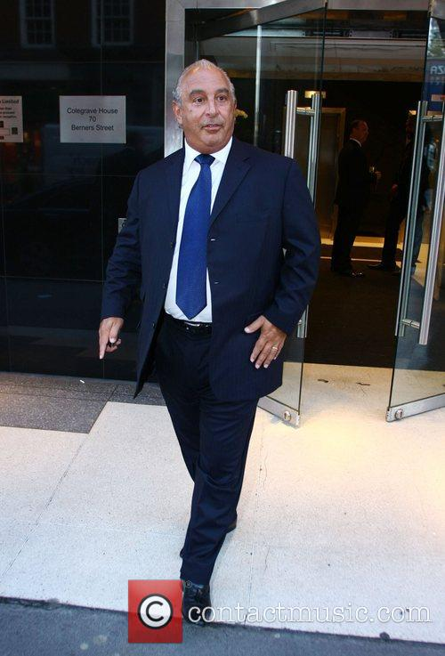 Philip Green leaves his offices after a business...