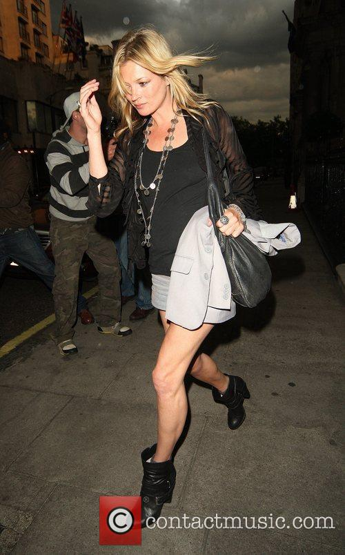 Kate Moss wearing black pixie boots leaves a...