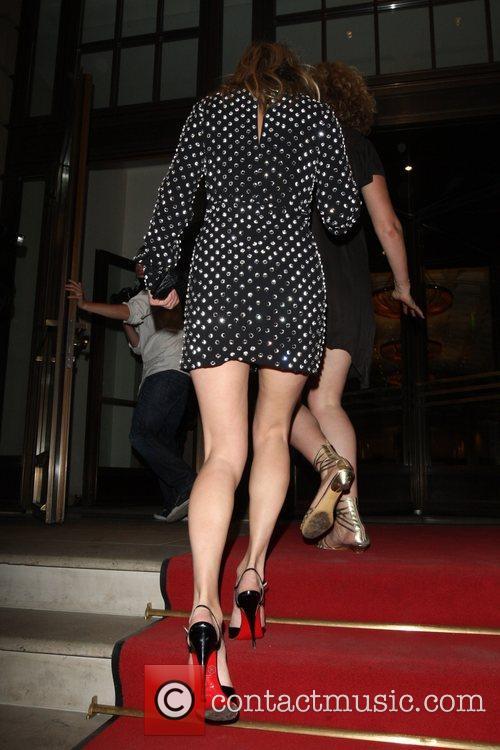 Arriving back at her hotel after leaving her...
