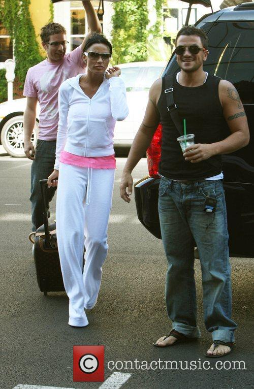 Katie Price AKA Jordan arriving with her husband...
