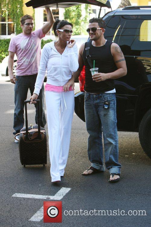 Katie Price AKA Jordan arriving with her husband...