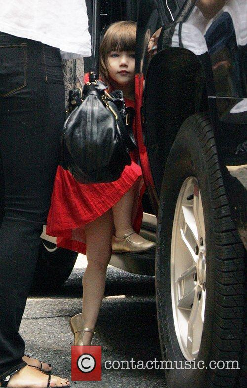 Out and about with her parents after Katie...