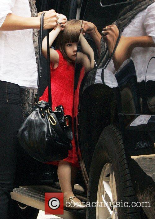 Suri Cruise out and about with her parents...