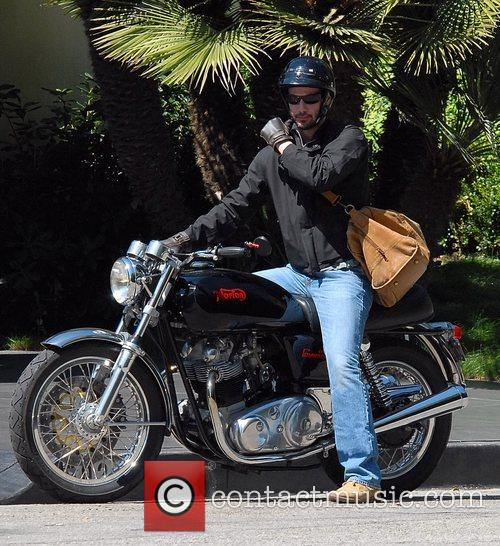 Keanu Reeves leaving his Hollywood residence on his...