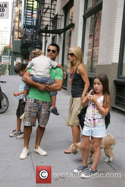 Kelly Ripa and Mark Consuelos take their children...