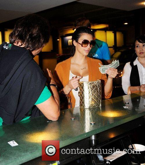 Kim Kardashian enjoying a night out with a...
