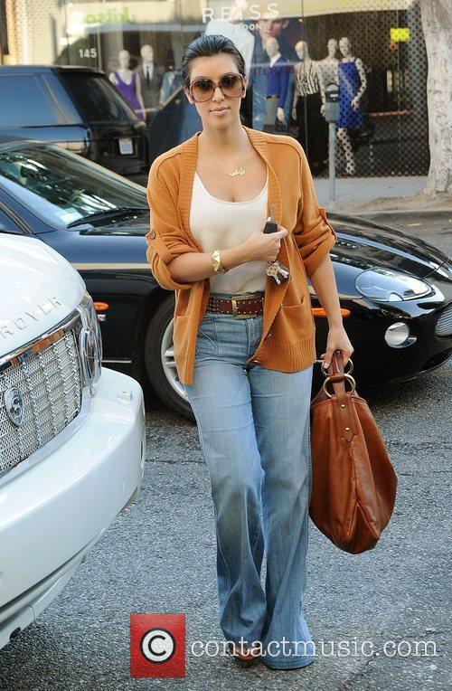 Kim Kardashian walking on Robertson Boulevard wearing blue...