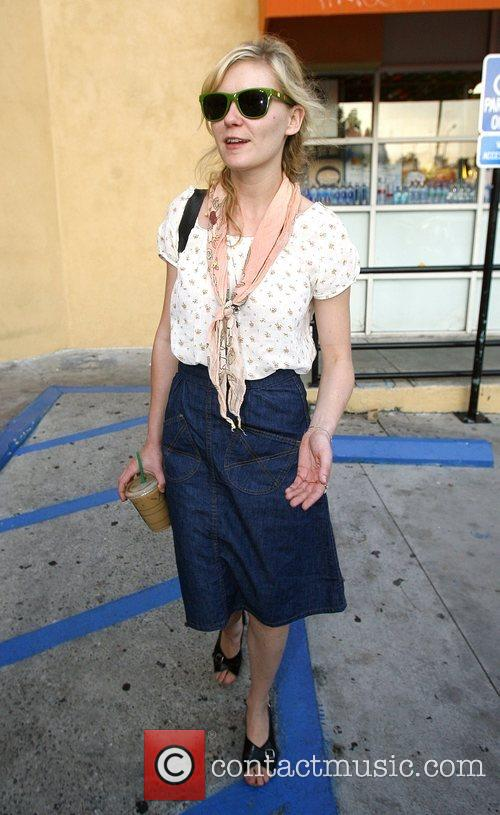 Kirsten Dunst grabs a Starbucks to go with...