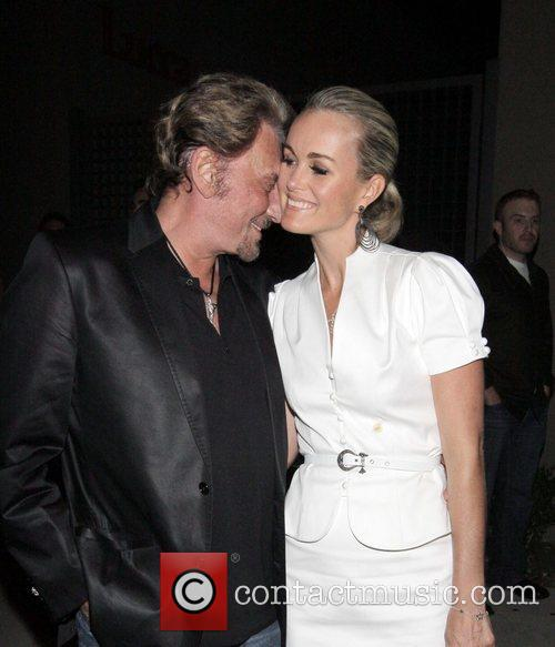 Johnny Hallyday outside Koi restaurant with his girlfriend...