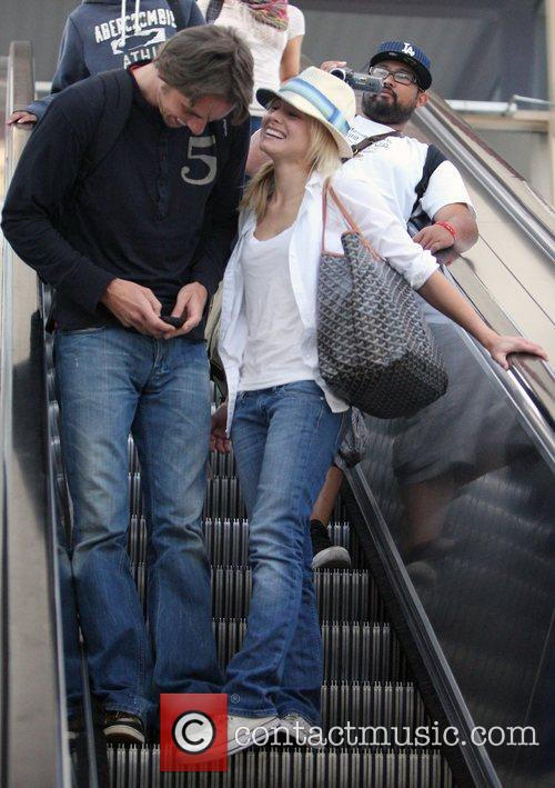 Are in good spirits as they arrive at...