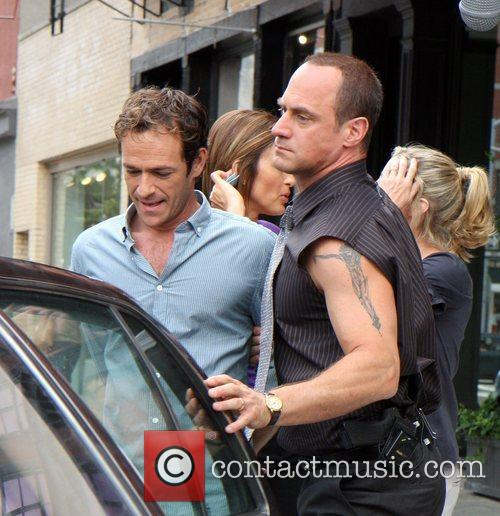 Luke Perry and Christopher Meloni filming an episode...