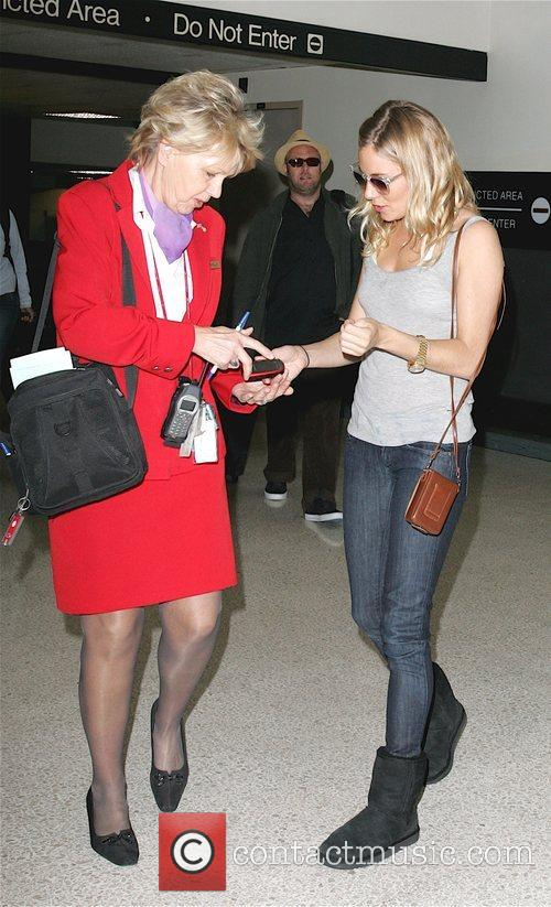 Arrives at LAX airport after jetting in from...