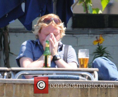 Leigh Francis  enjoys a beer with a...