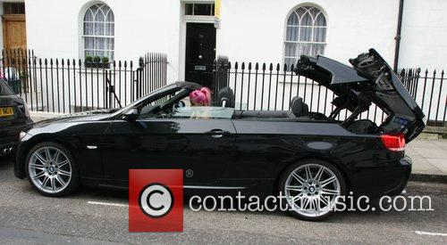 Lily Allen puts the roof down on her...