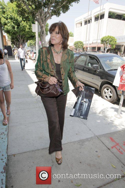Linda Gray walks from MAC costmetics boutique to...