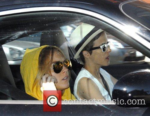 Lindsay Lohan and Samantha Ronson drive off after...