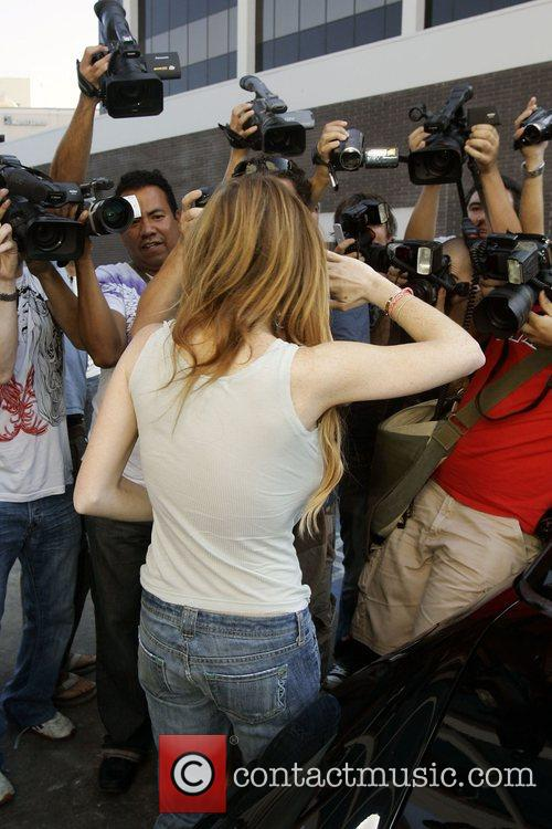 Lindsay Lohan leaving after shopping at Christian Dior...