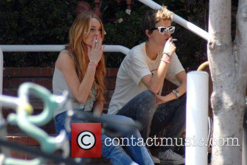 Lindsay Lohan and Samantha Ronson take a cigarette...