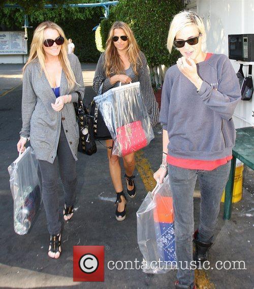 Lindsay Lohan, a friend and Samantha Ronson wait...