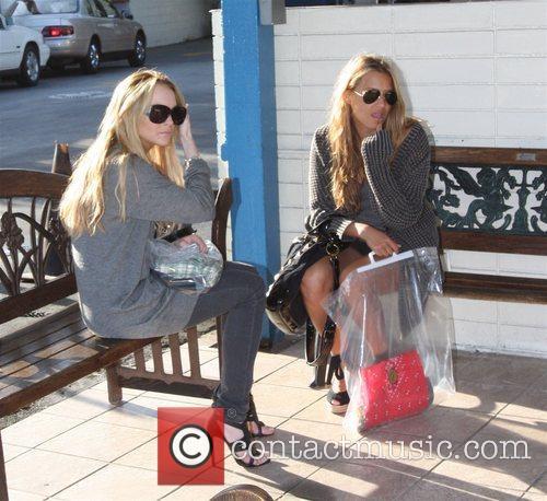 Lindsay Lohan and a friend  wait while...