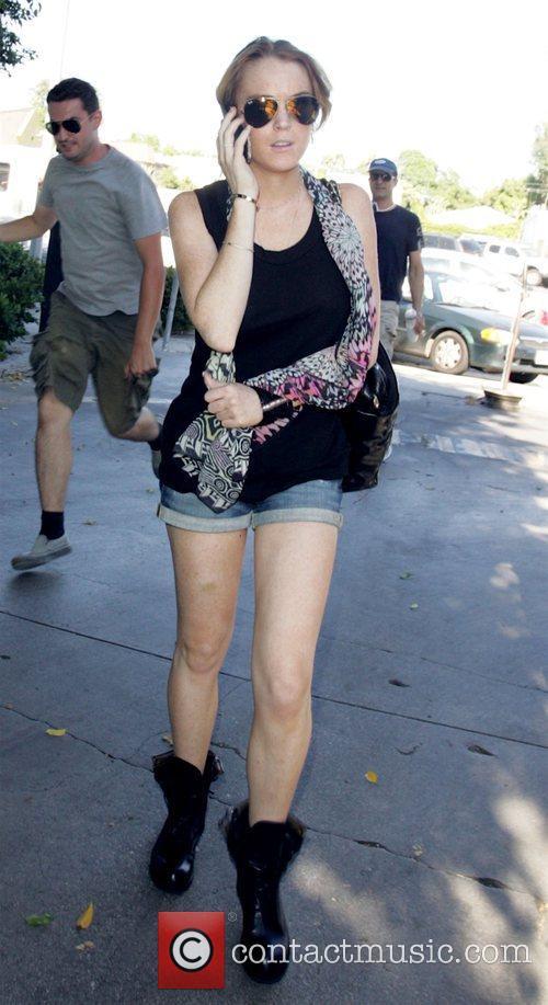 Lindsay Lohan chats on the phone as she...