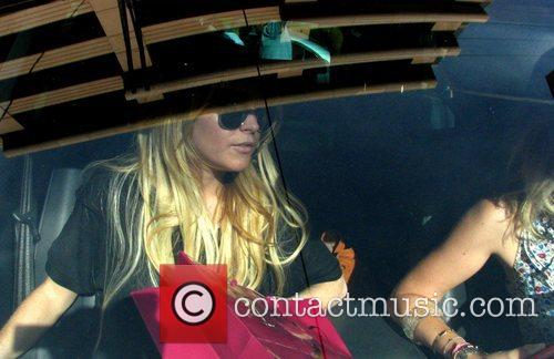 Lindsay Lohan is mobbed by photographers as she...