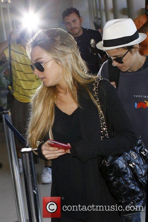 Lindsay Lohan and Samantha Ronson arrive at LAX...